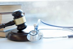 Stethoscope sitting next to a gavel