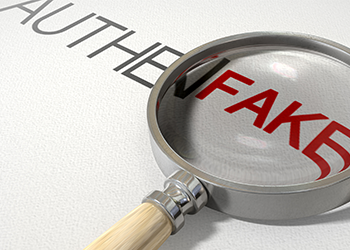 A magnifying glass over the word fake