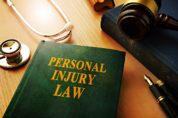 Personal Injury Law Book Next to Gavel and Stethoscope