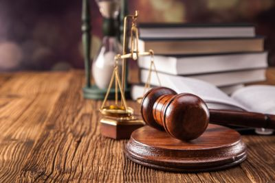 gavel, scales of justice, and stack of books on wood table