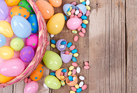 Easter basket and eggs with candy spilling out