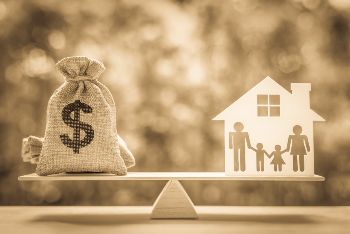 Money and Home with Family on a Balance Scale
