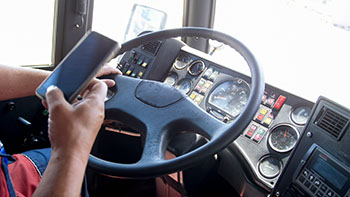 Truck driver using their phone irresponsibly while driving