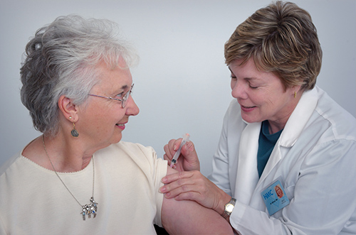 Woman getting a checkup from a doctor