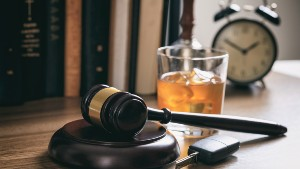 Gavel with drink