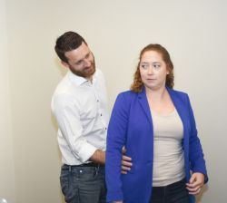 man touching coworker inappropriately