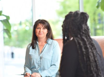 Sue Palmer happily working with a client