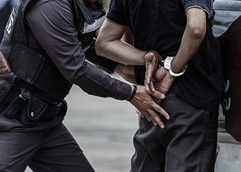 Man being arrested by a police office