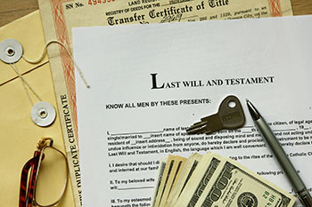 Last Will and Testament with a key, money, and transfer certificate of title