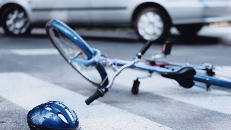Bicycle and Helmet on the asphalt