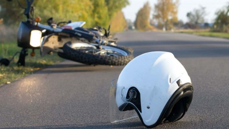 Motorcycle Helmet on ground by crashed motorcycle