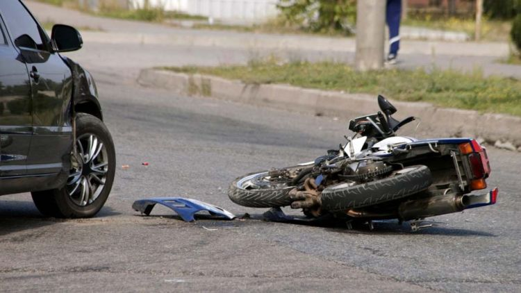 Motorcycle and Car on road after accident