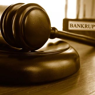 Gavel in front of Bankruptcy Law Book