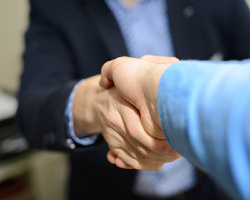 Handshake between an attorney and their client