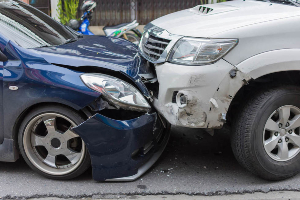 Head-on collision between two cars