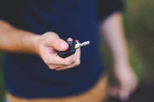 Blurry photo of a person holding car keys