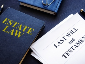 """Books and documents that read """"Estate Law"""" and """"Last Will and Testament"""""""