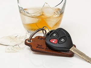 Glass of alcohol and car keys nearby