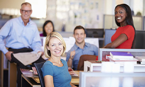 Photo of happy office workers in the office