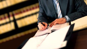 Attorney writing in a book