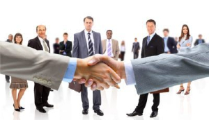 Handshake in front of a group of business people