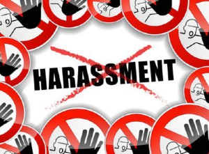 Graphic of a bunch of crossed out signs and reading HARASSMENT