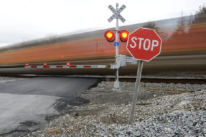 Railroad crossing with a training running through it
