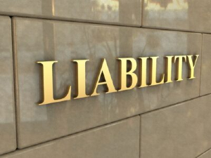 """Letters on the side of a building that read """"LIABILITY"""""""
