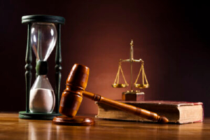 Gavel, hourglass, and scales of justice