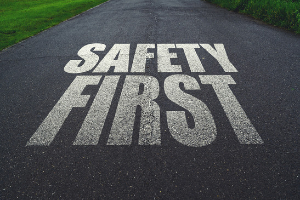 """The words """"SAFETY FIRST"""" painted on a road"""