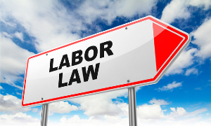 """Street sign that reads """"LABOR LAW"""""""