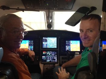 Mark Sullivan and his son in a high-performance airplane