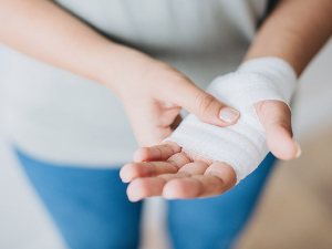 Hand wrapped in bandages