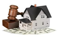 House next to gavel and money
