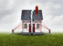 House splitting with two figures running away from it