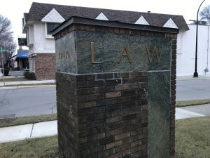 Brick mailbox with Law on it