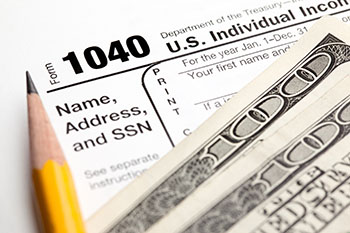 1040 Tax document with $200 on top of it
