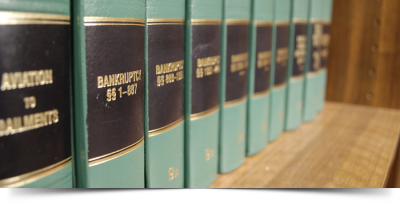 Bankruptcy books lined up on a shelf