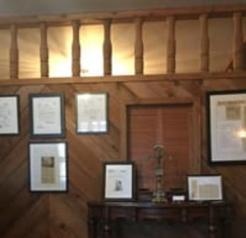 Framed documents in office