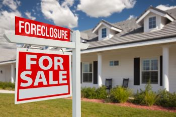 Foreclosure Home For Sale Real Estate Sign in Front of New House