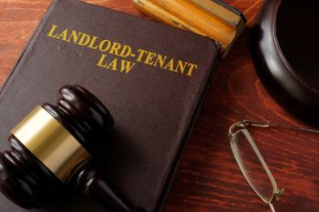 Landlord-Tenant Law book with a gavel on top