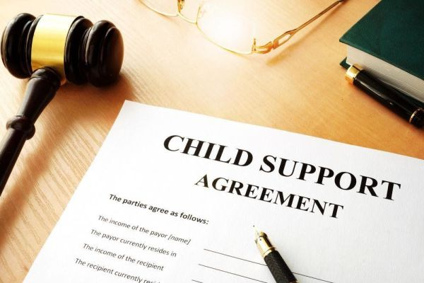 Child Support Agreement next to a gavel