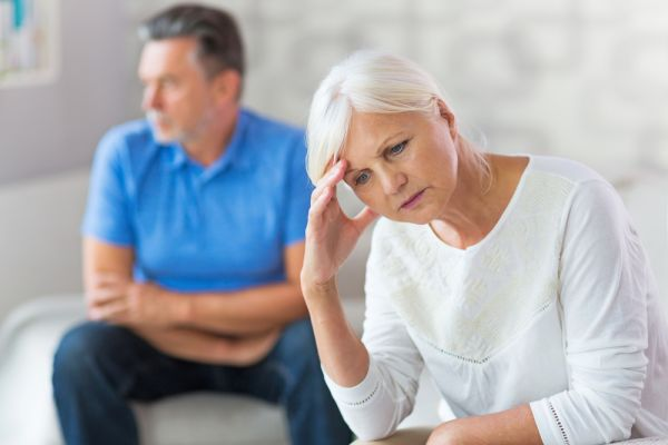 Upset elderly couple