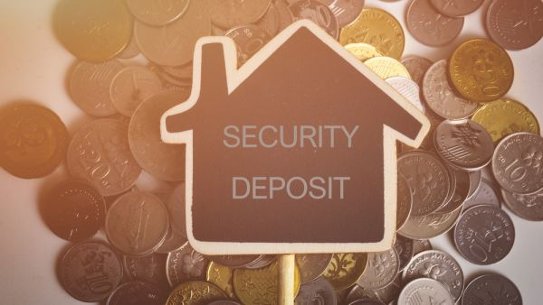 Home security deposit on top of coins