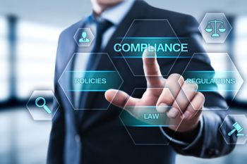 Man in suit pointing to graphic that says compliance, policies, law, and regulations