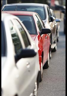 Three cars in traffic