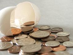 Broken egg spilling coins