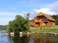 Large wooden cabin on a lake