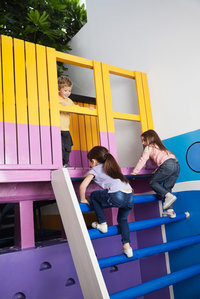 Three children playing on on a playground