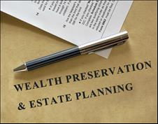 Pen on a wealth preservation and estate planning document